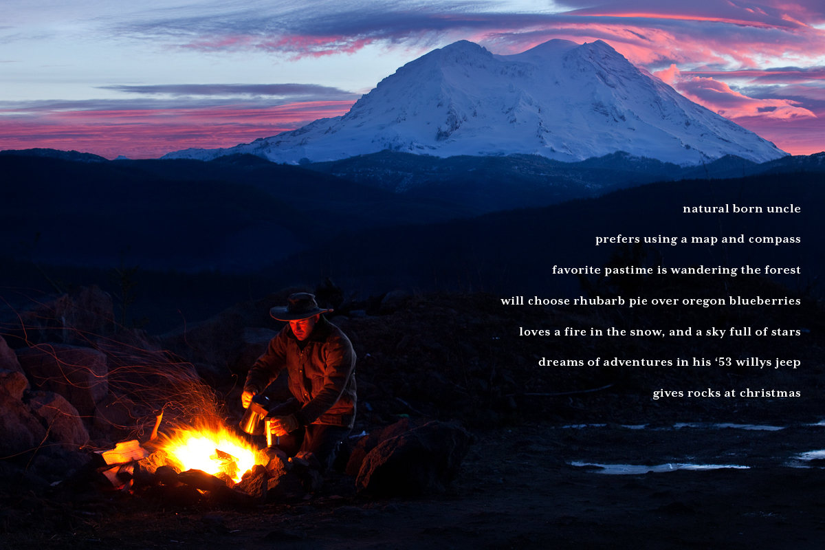 Rugged outdoorsman pours coffee by camp firelight with Mt. Rainer sunrise behind