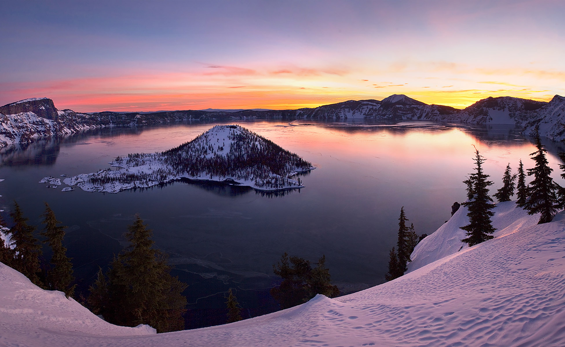 Beautiful sunrise over Crater Lake Oregon in the snow.