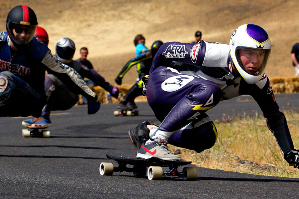 A determined longboard skateboarder rounds the corner during a race at the Maryhill Festival of Speed in eastern Washington