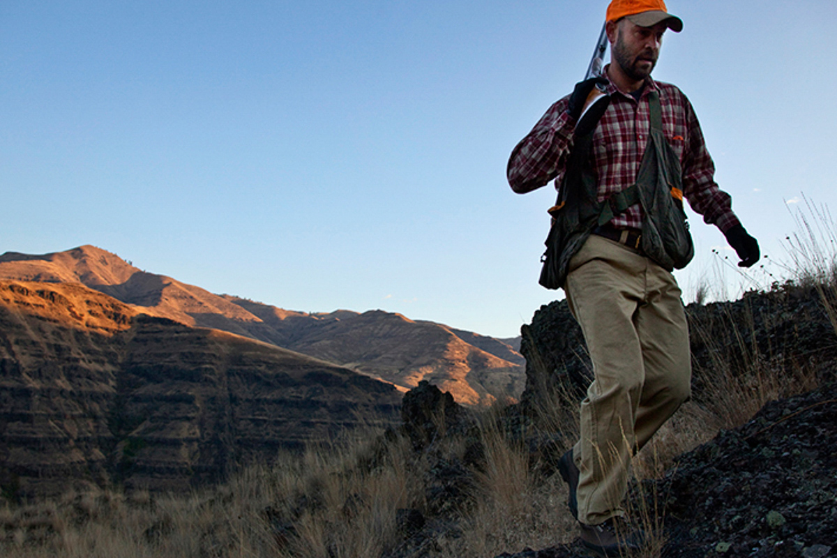 A bird hunter climbing a ridge in Eastern Oregon.