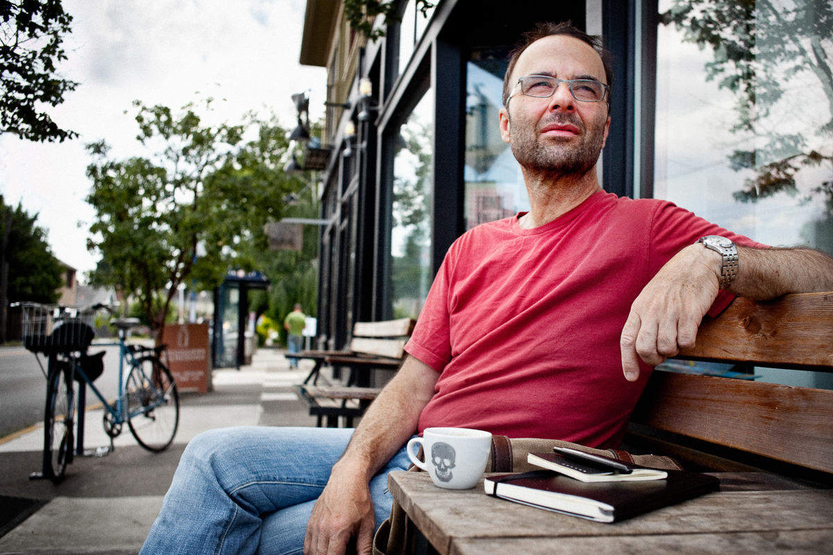 PSU Professor and writer on coffee shop bench
