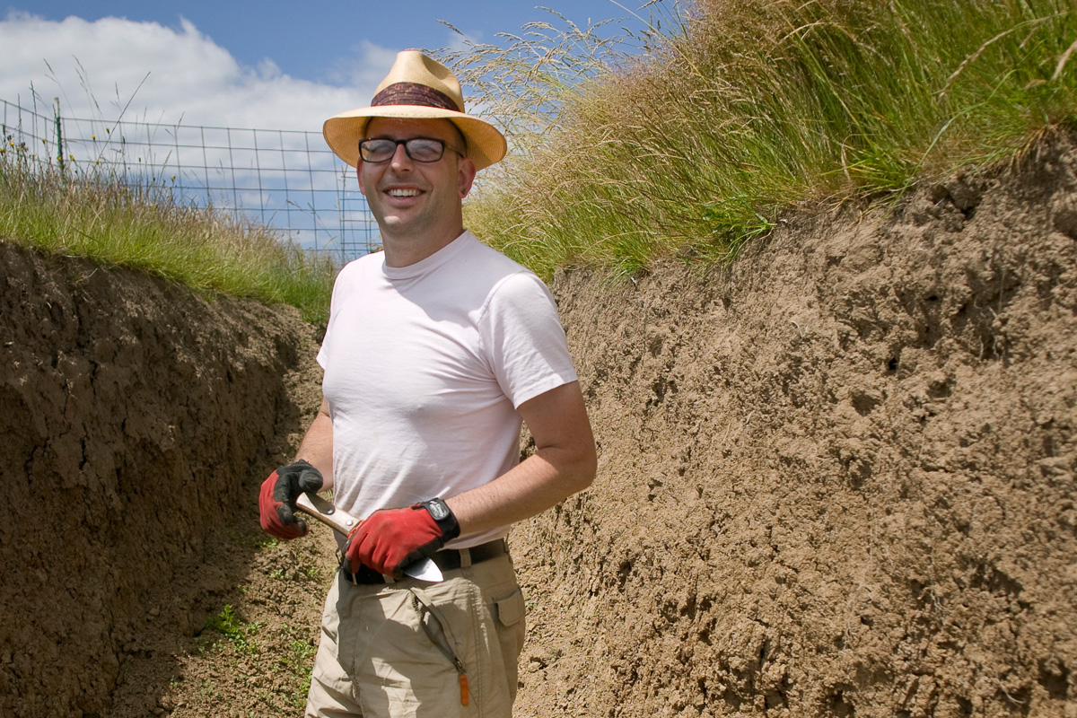 OSU soils professor in trench